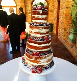 Wedding Cakes   Les Amis Bake Shoppe Four tiered naked wedding cake adorned with fresh fruit