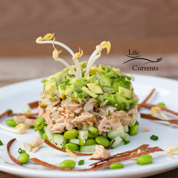 Island Trollers Albacore Tuna Tower with cucumber, edamame, water chestnuts, avocado, and served with soy sauce, bean sprouts, & crispy baked won tons