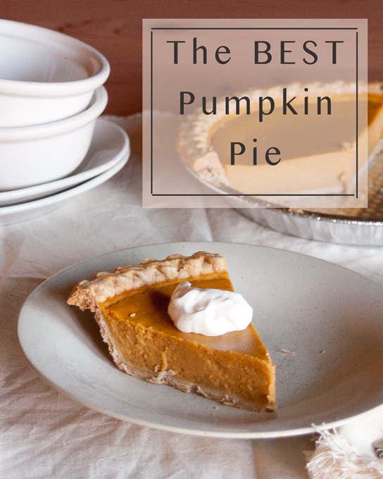 This is the best Pumpkin Pie ever, seriously! A nice slice of Pumpkin pie on a plate with whipped cream, and the rest of the pie in the background