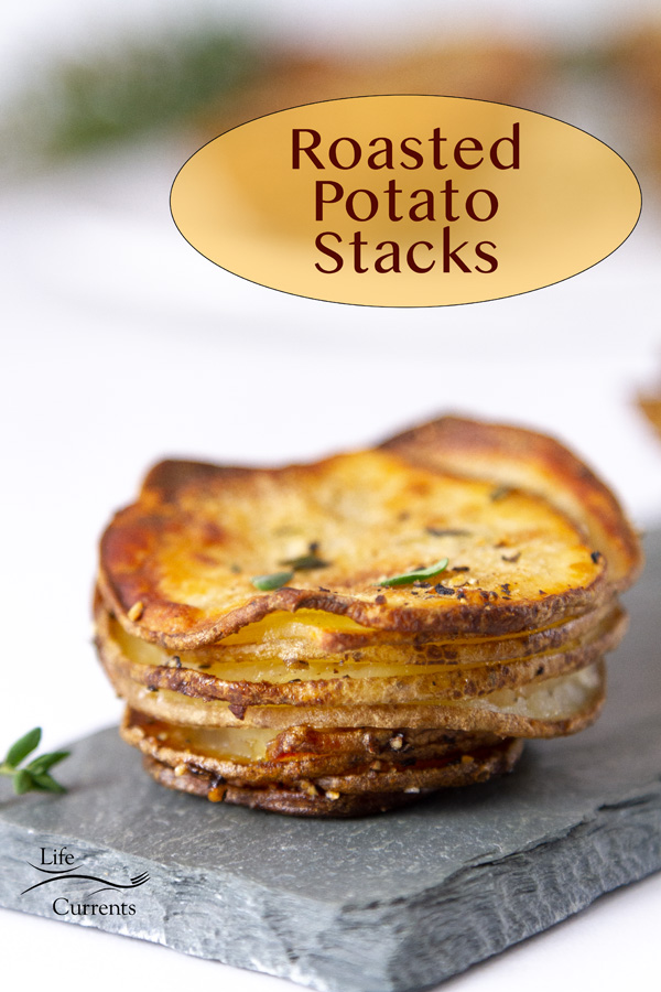sliced poatoes stacked and baked served on a slate board, title on image:Roasted Potato Stacks.
