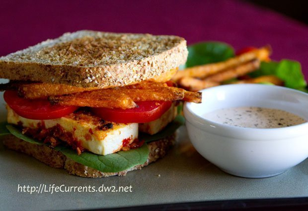 spicy crispy tofu sandwich: With fresh spinach, tomatoes, sweet potato fries, and chipotle-sour cream sauce on toasted sprouted 7-grain bread vegetarian lifecurrentsblog.com