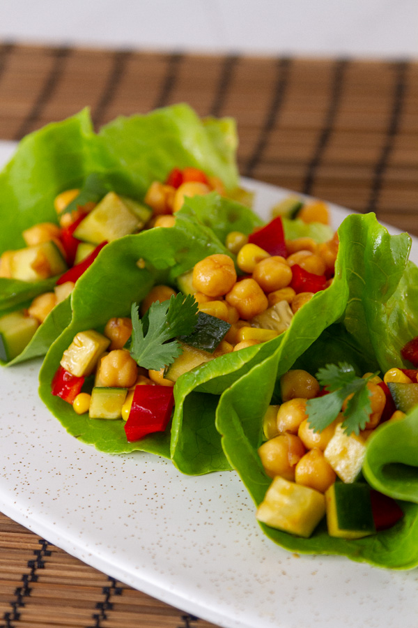 lettuce wraps filled with chickpeas, red pepper, cucmber, cilantro.