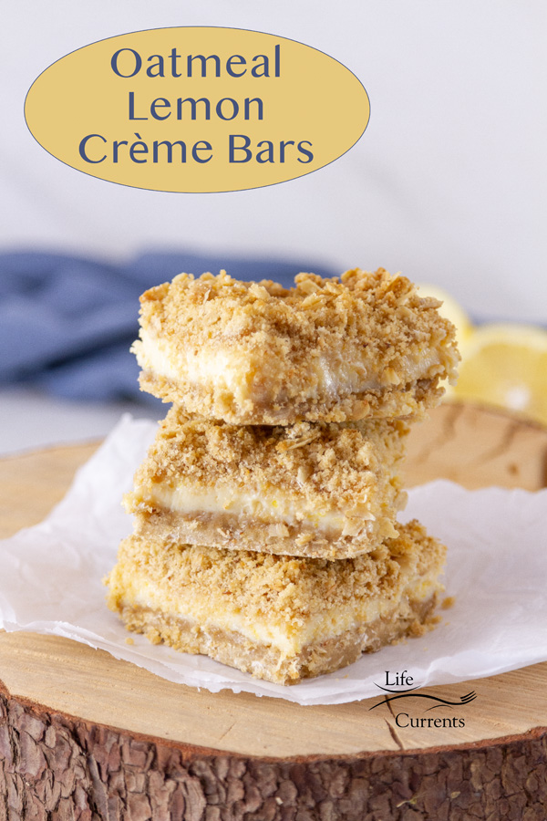 stack of Oatmeal Lemon Crème Bars on a piece of parchment paper on a wooden platter, title on image.