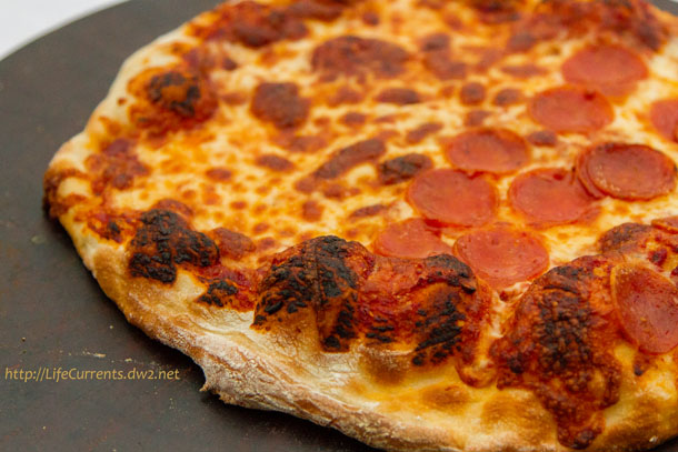 This Homemade Thin Crust Pizza from ATK is da bomb! And, when it's served with my pizza sauce, there's no need to go out to a pizza place. https://lifecurrentsblog.com