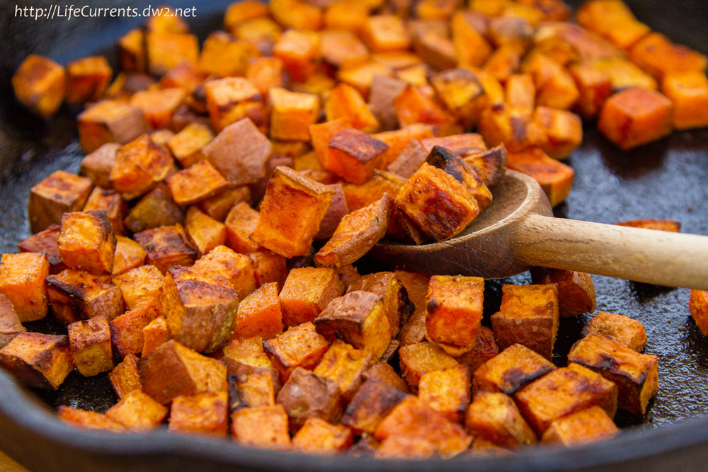cubed potatoes in a skillet