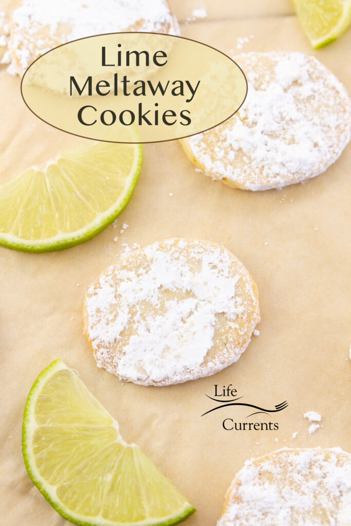 Lime Meltaway Cookies on parchment paper with slices of lime, title in upper left.