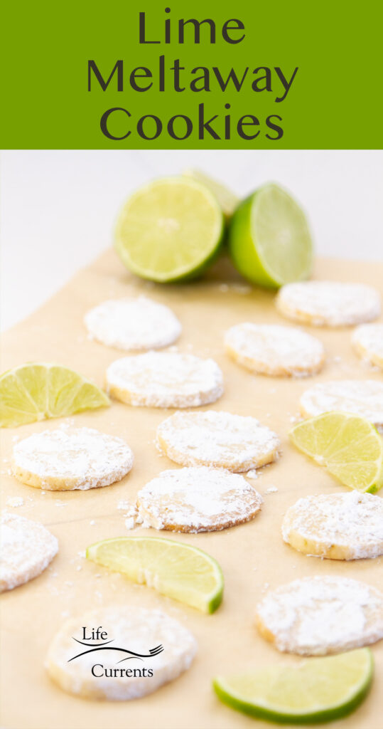 a tray full of cookies with slices of lime, title on top: Lime Meltaway Cookies.