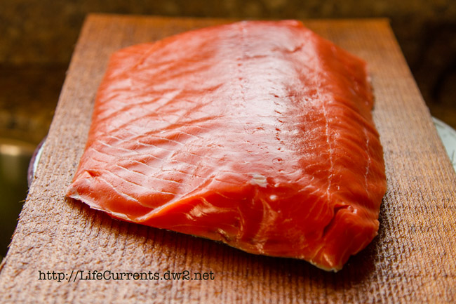 a large piece of raw salmon