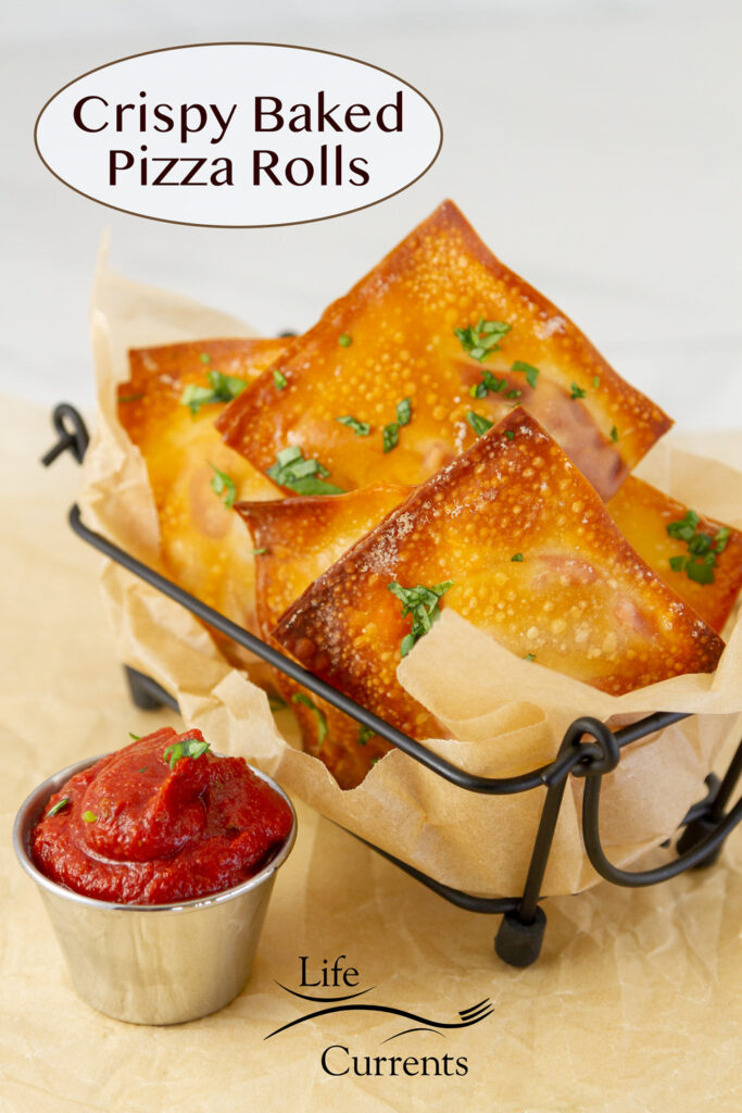 pizza rolls in a wire container for servings, along with a side of pizza sauce.