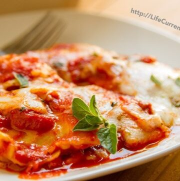 Ravioli Lasagna is the perfect weeknight dinner! Spoiler alert! You don't even have to boil the ravioli! http://lifecurrentsblog.com