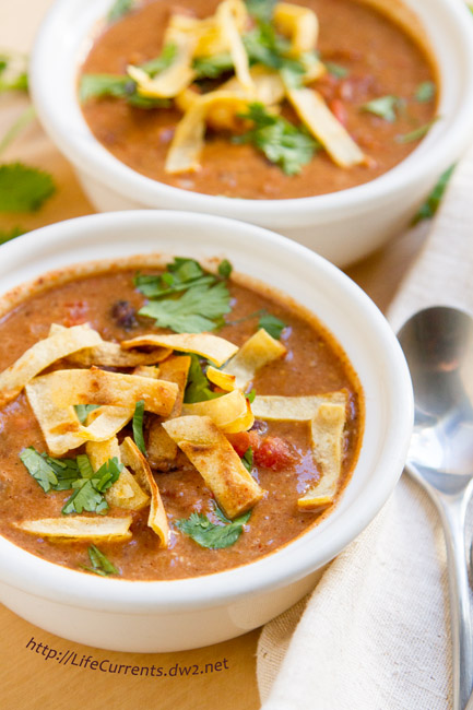 Slow Cooker Creamy Tortilla Soup is a great comforting soup. And, it's awesome that you can simply throw all the ingredients in the crock pot (slow cooker) and get a wholesome and yummy dinner! #MeatlessMondayNight