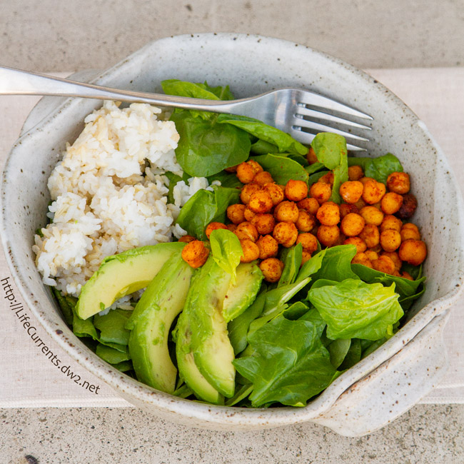 Salad with spiced roasted chickpeas, healthy avocado, brown and white rice, and big handfuls of fresh spinach!