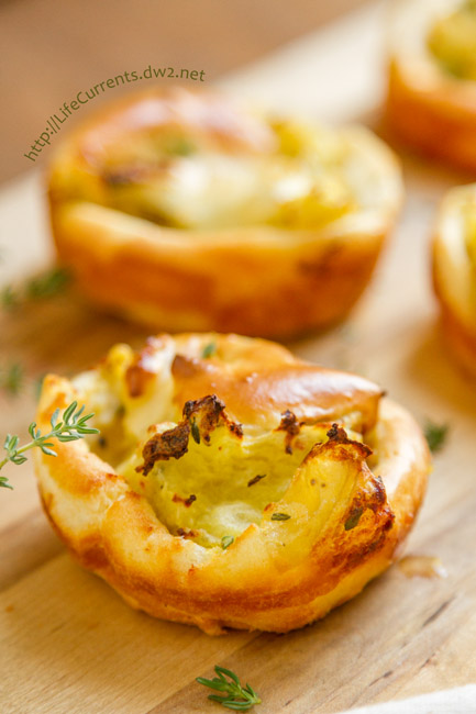 Savory Mashed Potato Puffs - Baked breads stuffed with thyme mashed potatoes are a great side dish and a fiun way to use leftover mashed potatoes