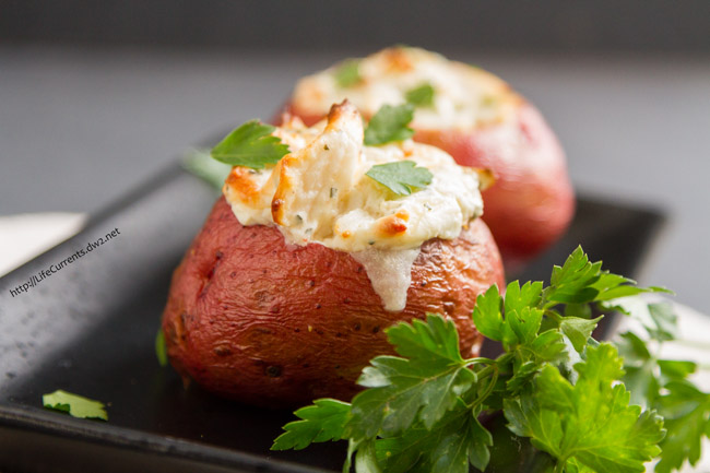 Crab Stuffed Baked Potatoes - I served these Crab Stuffed Baked Potatoes for Christmas Eve dinner this year. They were fabulous! Rich creamy crab filling inside earthy baked potatoes. They were a huge hit, and I really liked that they were just a small amount of rich fancy food at a pretty healthy meal.