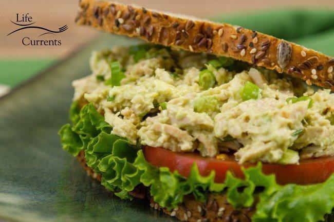 Sandwich with lettuce, tomato, and tuna.