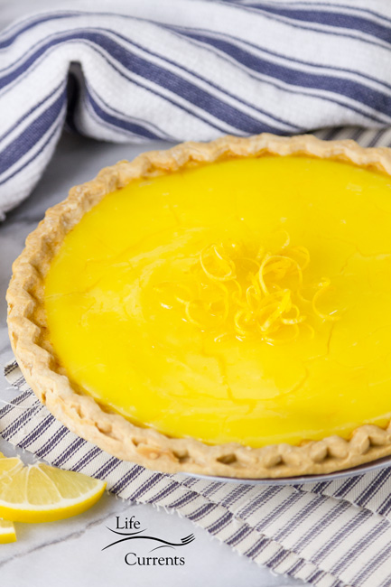 Grandma's Lemon Custard Pie - the whole pie that hasn't been cut into yet garnished with lemon zest
