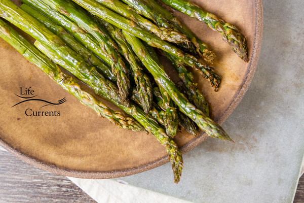 asparagus on a brown plate