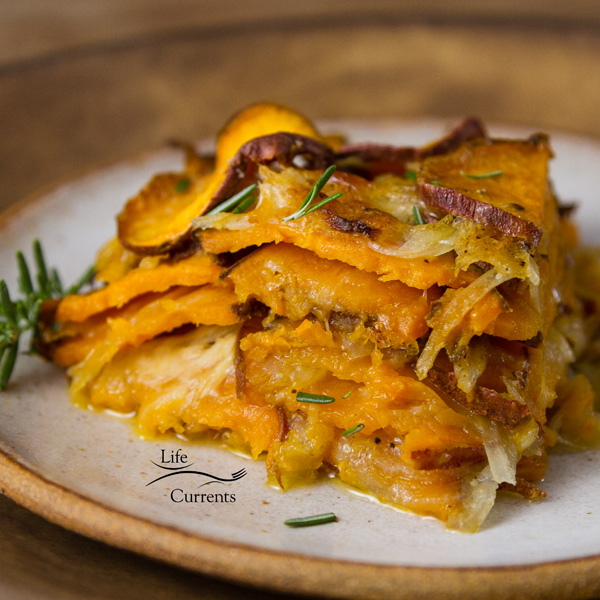 Sweet Potato side dish - Sliced sweet potatoes are layered with onions and a light creamy cheese sauce, then this skinny side dish is baked up so the veggies are tender and delicious