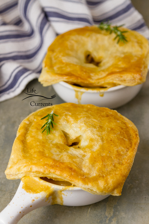 Sausage and Potato Pot Pie – hearty sausage and potato stew with in creamy delicious gravy all covered in flakey puff pastry. What could be better! #comfortfood