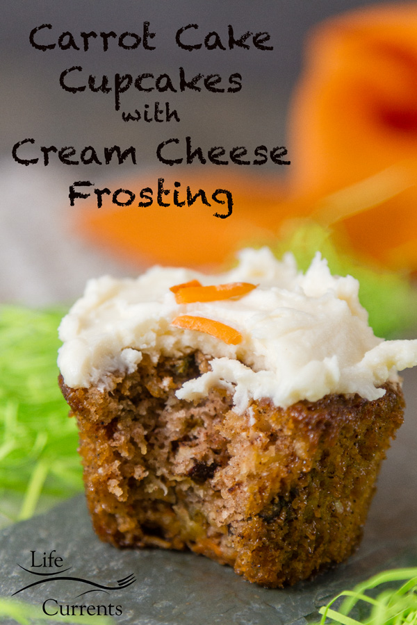 Carrot Cake Cupcakes with Cream Cheese Frosting - packed with grated carrots, coconut, pineapple, and pecans for a moist tender cake that's lighter in calories than most cakes.
