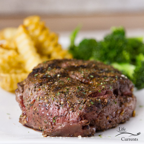 Steak cooked and on a plate with fries and broccoli