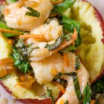 shrimp and veggies stuffed in a baked sweet potato