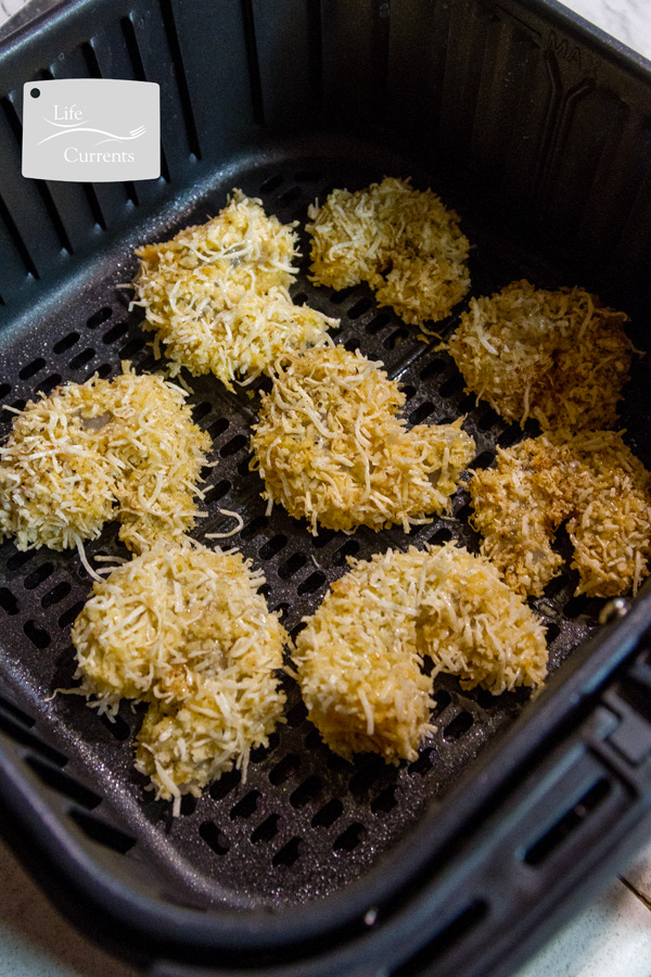 breaded shrimp in the basket of an Air Fryer