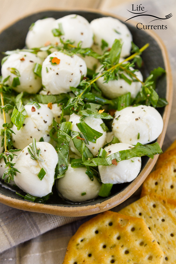Marinated Mozzarella Appetizer Recipe in a bowl served with crackers