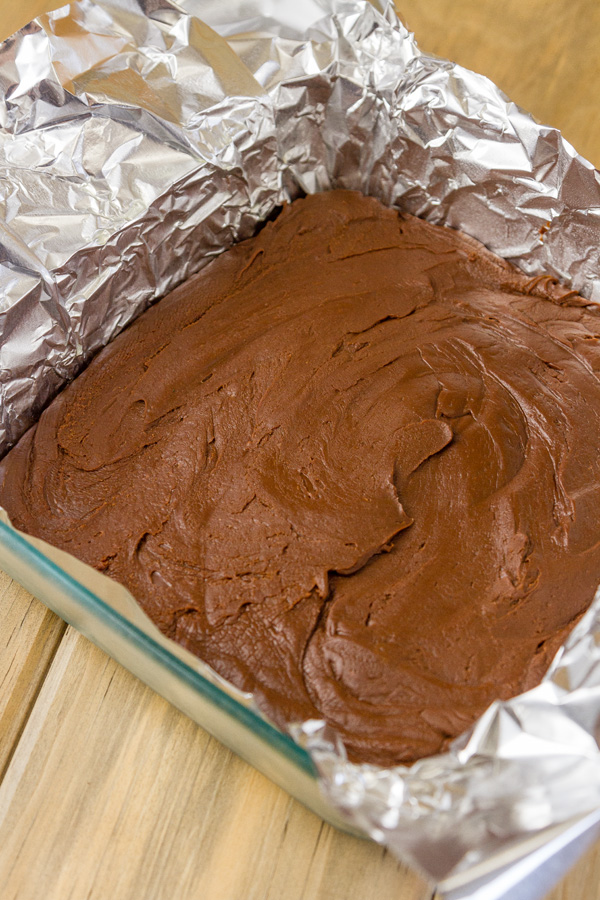 A pan of fudge using aluminum foil to help get the fudge out of the pan