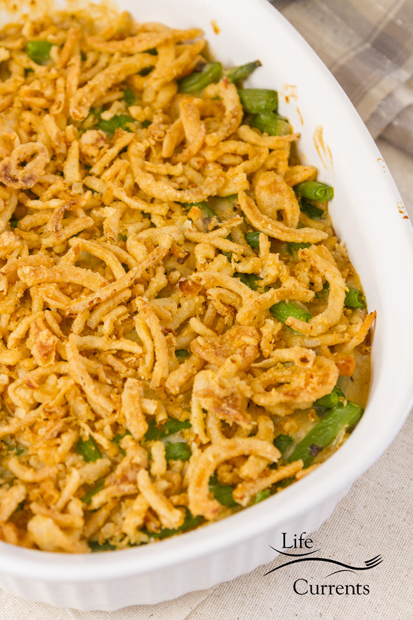 Green bean casserole covered with fried onions in a casserole dish