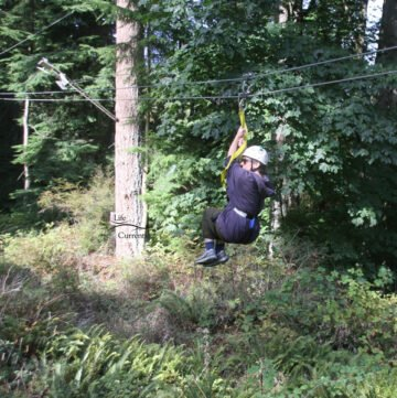 Me on a zipline in the middle of the forest
