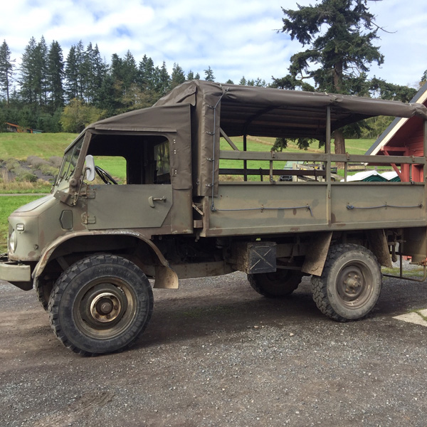 Unimog vehicle, which is a 1963 Swiss Army troop carrier