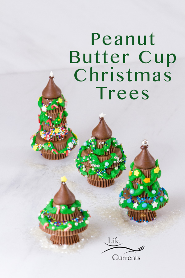 4 Christmas trees made from peanut butter cups decorated with icing and sprinkles and the title
