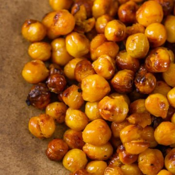close up of Buffalo Roasted Chickpeas on a brown plate
