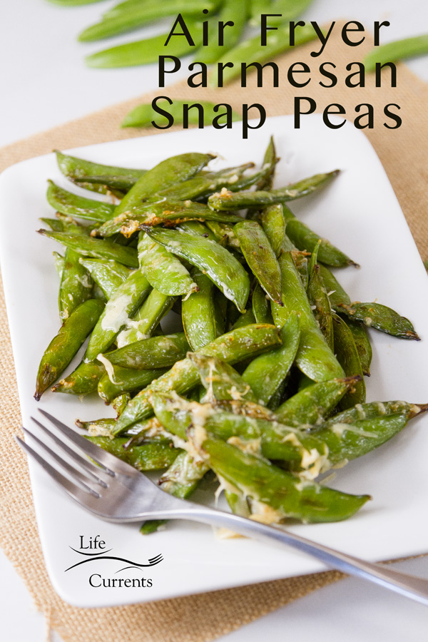 Air Fryer Parmesan Sugar Snap Peas on a white plate with a fork