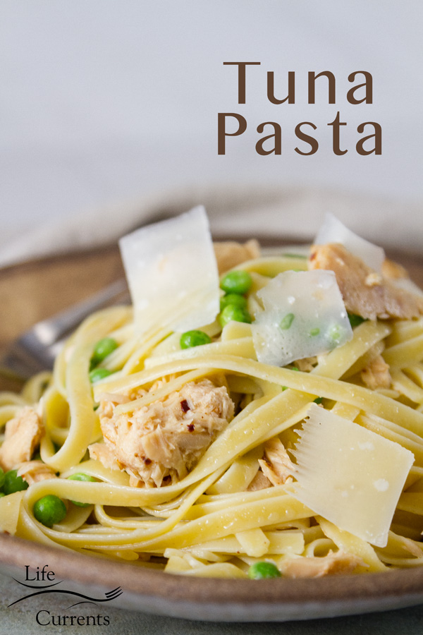 A brown bowl filled with Easy Weeknight Tuna Pasta Dinner and topped with Parmesan shavings, title added to photo