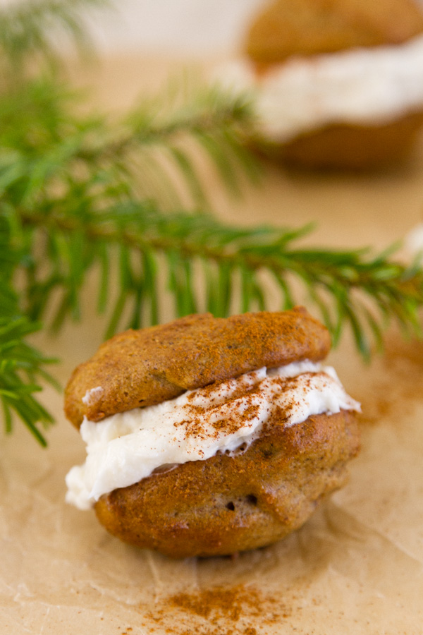 Spice Cakes with creme filling and a dash of cinnamon with evergreen boughs