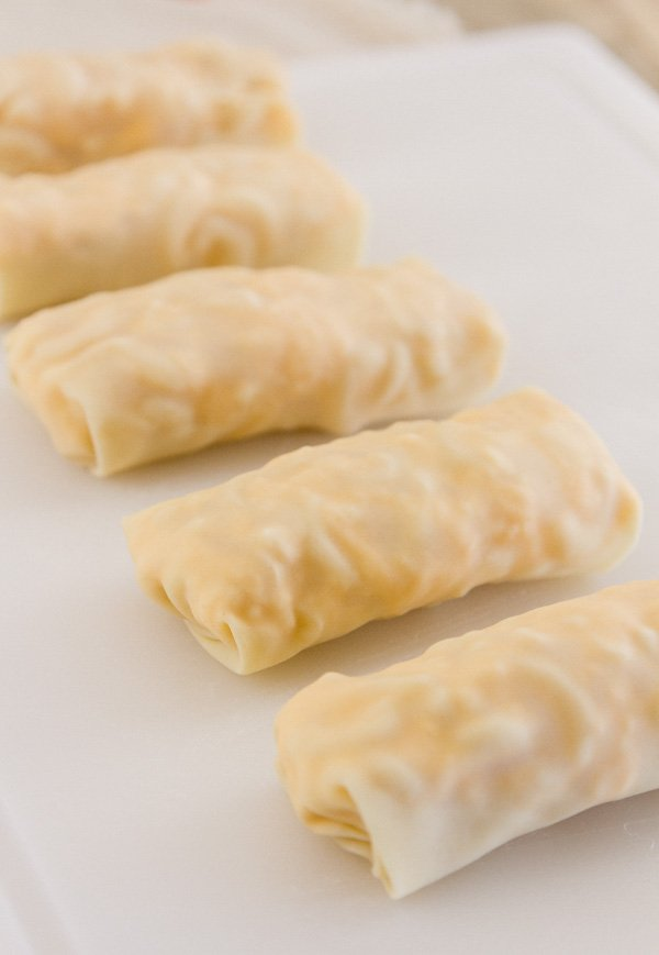 egg rolls rolled and ready to be cooked