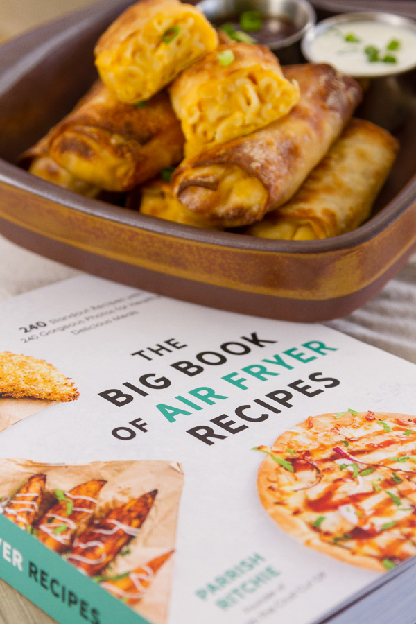 Recipe from The Big Book of Air Fryer Recipes with the book and the egg rolls in the picture