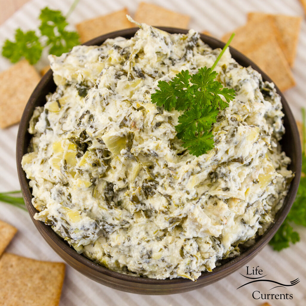 top down square crop image of spinach dip in a bowl