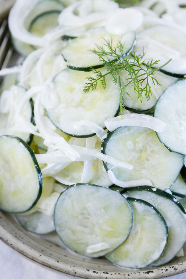 close up of salad in a bowl garnished with dill