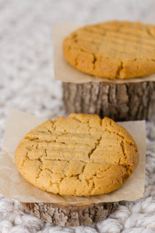 two cookies on wooden blocks