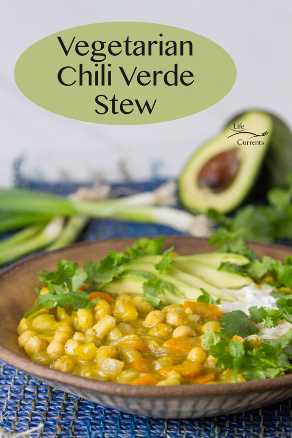 Vegetarian Chili Verde Stew in a bowl with an avocado, green onions, and cilantro in the background. Title on image