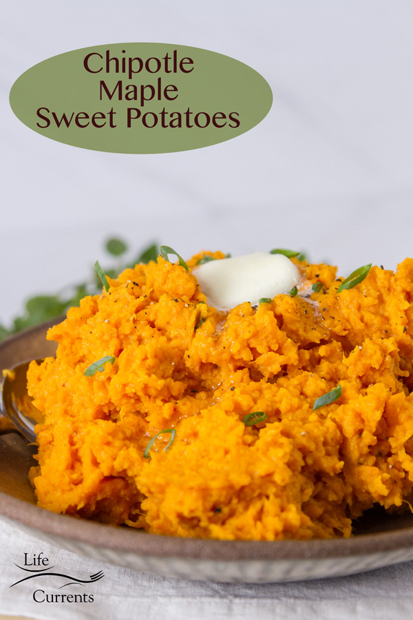 Chipotle Maple Sweet Potatoes on a brown plate garnished with green onions and a pat of butter. Title on top