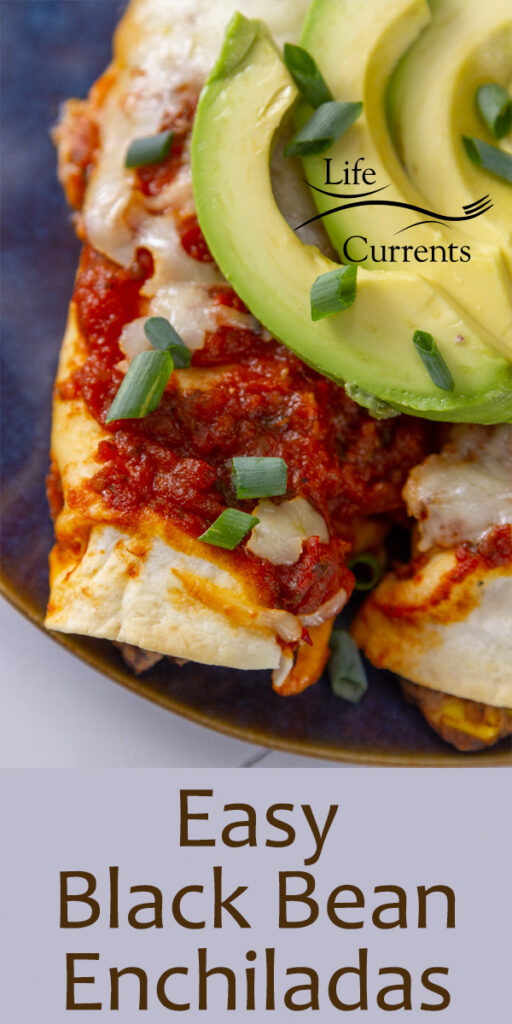 close up of an enchilada on a blue plate topped with avocado, title on image: Easy Black Bean Enchiladas.