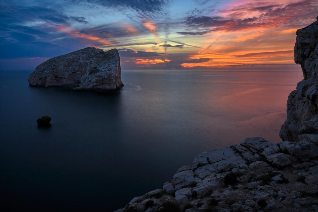 Sunset At Capo Caccia Isola Foradadda Near Alghero Sardi