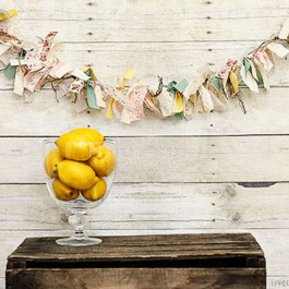 How to make a fabric banner using scrap! Love the sweet vintage feel too! livelaughrowe.com