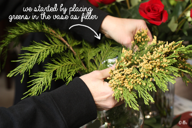 when adding some fillers, start by placing that in your vase around the edges