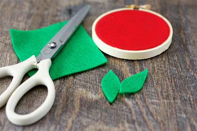 Cut leaf or leaves from green felt.