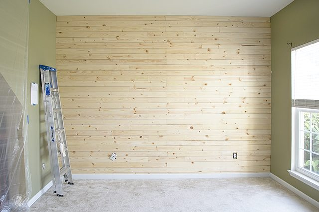 Sanding and prepping the wall for paint!